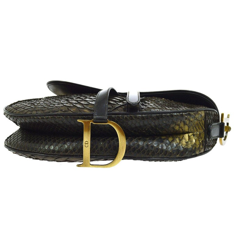 Christian Dior Brown Gold Exotic Snakeskin Saddle Leather 'CD' Logo Charm Shoulder Bag   Python Snakeskin Leather trim Gold tone hardware Velcro closure Woven lining Made in Italy Shoulder strap drop 6.5