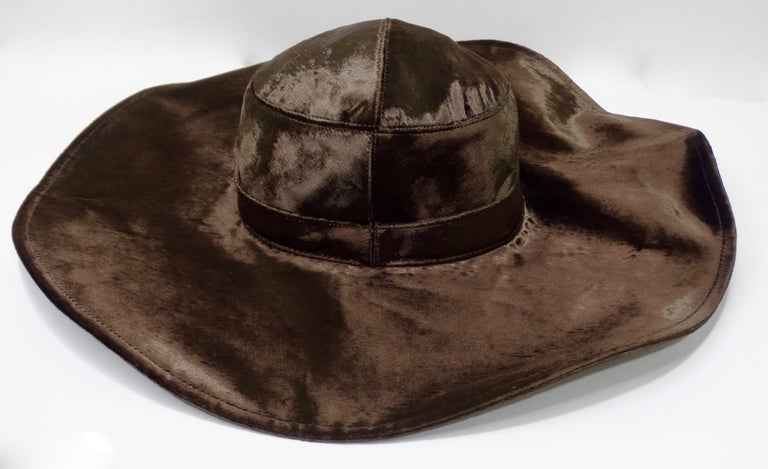 Too a-dior-able 70's style created in the 1990s (most likely from the Galliano era), this Dior sun hat is crafted from chocolate brown viscose velvet and features a wide floppy brim with a wire trim for a structured look. Interior is lined with the