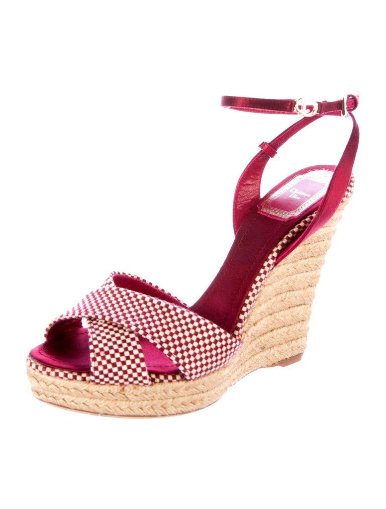If you're already a fan of wedge heel espadrilles, you'll love this pair Christian Dior - they're set on a jute wedge heel for comfortable lift. . Wear them on vacation with pretty dresses or cuffed denim.  Beautiful burgundy and creme satin