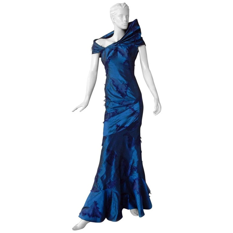 A rare Christian Dior by John Galliano f/w 1999 sapphire blue eyelash silk bias cut gown.  Designed with the utmost attention to couture detailing and sophisticated construction.  Gown is created with  impressive sculptural details such as the