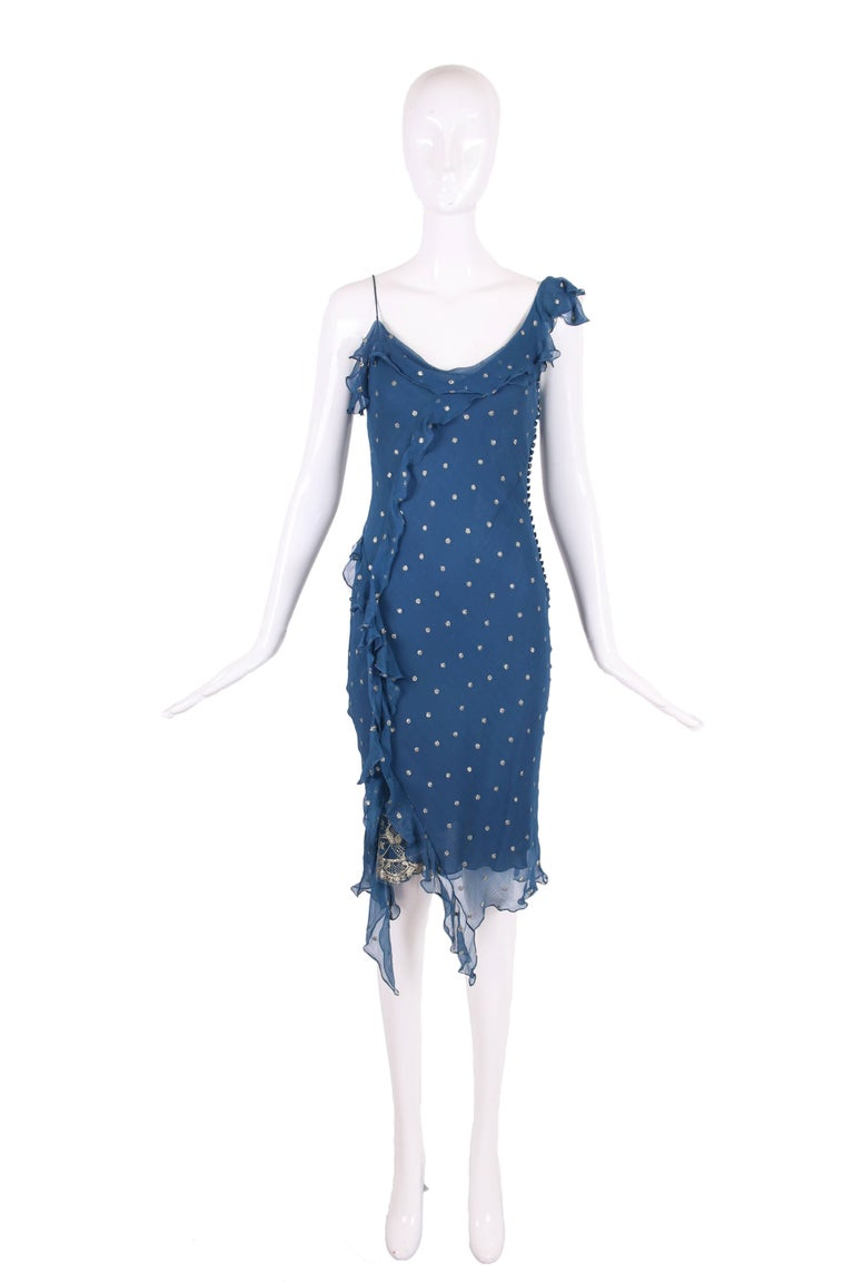 Christian Dior by John Galliano blue silk chiffon bias cut cocktail dress with metallic gold polka dots and a gold metallic lace insert at the side seam hem. There is a blue slip attached underneath. In very good condition with some minor pulls to