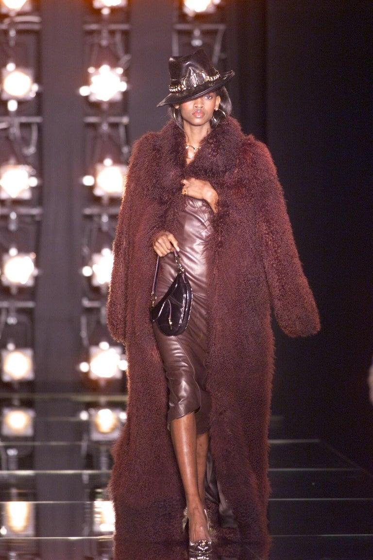 Christian Dior by John Galliano; brown lambskin leather strapless bustier dress. Bias cut seams twist around the body.   Fall-Winter 2000