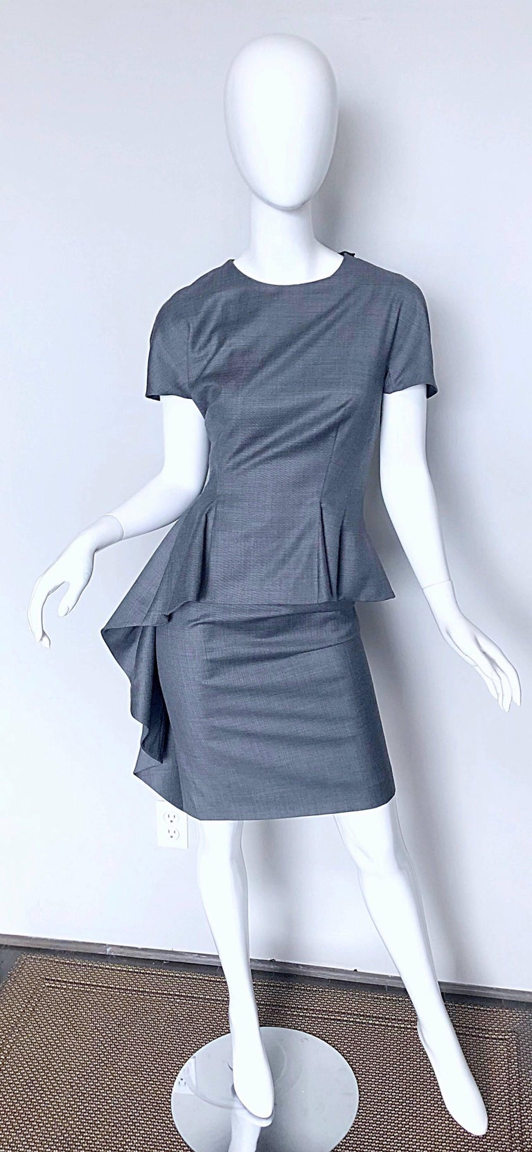 Gorgeous new with tags CHRISTIAN DIOR by JOHN GALLIANO lightweight wool light grey wiggle dress! There is so much detail to this dress--it is seriously couture quality! Features a tailored form fitting bodice and skirt. Peplum attached to the skirt