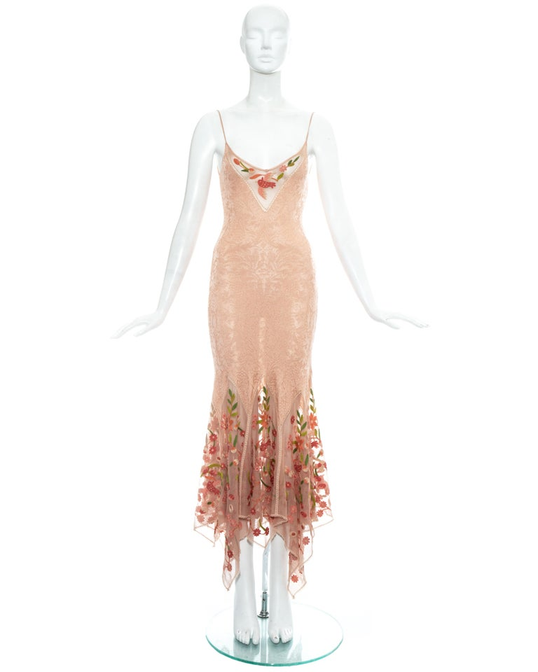 Christian Dior by John Galliano, peach knitted summer dress with floral embroidered mesh inserts and handkerchief hemline skirt.  Spring-Summer 2005