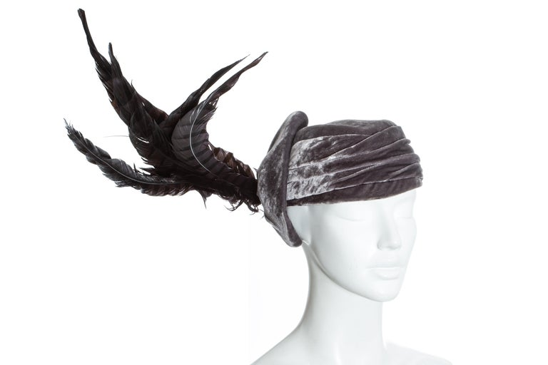 Christian Dior by John Galliano purple velvet pill box hat with large sweeping feathers. Probably designed by Steven Jones  c. 2000 - 2010