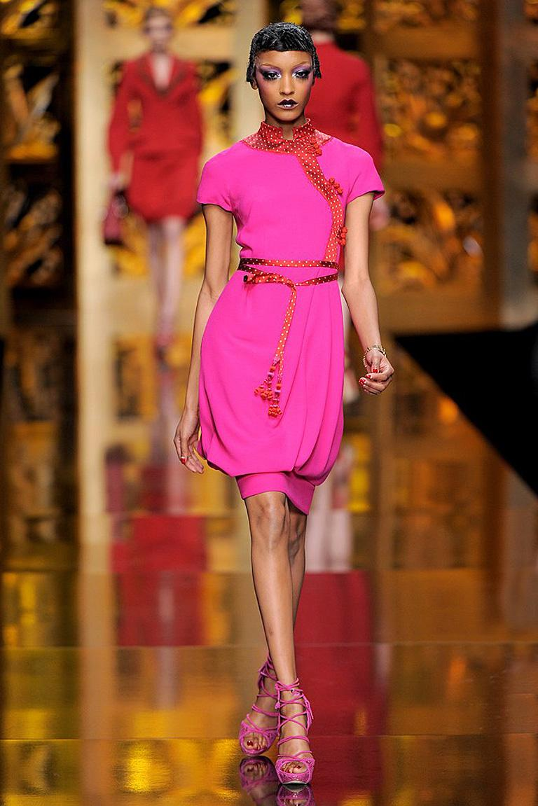 The Fall 2009 Dior Runway Collection by John Galliano was created lightly based on the orientalism of Paul Poiret and a century past Parisian Couture fashion.     Fashioned in  raspberry and red silk and wool dress designed with an Asian influence