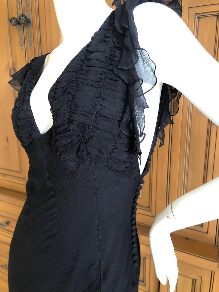 Christian Dior by John Galliano Seductive Low Cut Bias Cut Black Silk Dress This is so pretty, please use the zoom to see the details. Cut very low in front , back and under the arms, this is amazing on  Size 42  Bust 36