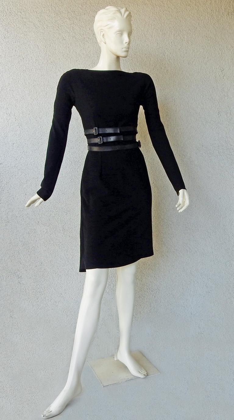 Christian Dior by John Galliano tailored black wool dress inspired by 1950's Christian Dior Haute Couture fashion.  Beautifully designed featuring fitted sheath style dress with draped bustle reflecting the draping and style of the New Look