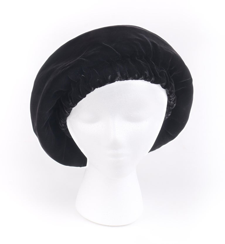CHRISTIAN DIOR Chapeaux c.1960's Marc Bohan Black Gathered Velvet Beret Hat   Circa: 1960's Labels: Christian Dior / Chapeaux / Paris - New York  Designer: Marc Bohan Style: Beret  Color(s): Black Lined: Yes  Unmarked Fabric Content (feel of):