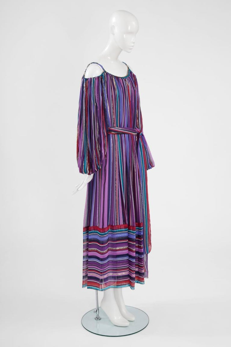 If you are looking for the ideal option for the season's upcoming weddings and garden parties, this 70's Dior by Marc Bohan gown could be it. Made from lightweight multicolor silk chiffon and gold Lurex « fil coupé », this cold-shoulder style dress