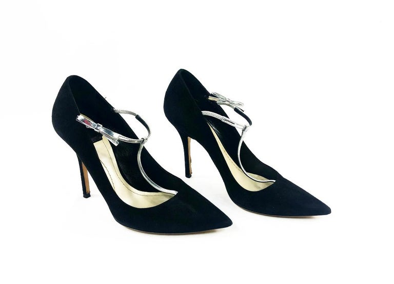Christian Dior COQUETTE Pump 10mm Black Suede w/ Silver Leather Bow Size 38  Product details: The shoes come with the original Dior box. Point toe Black suede w/ silver metallic leather stretchable strap w/ bow detail on the sides. Size 38 The heel