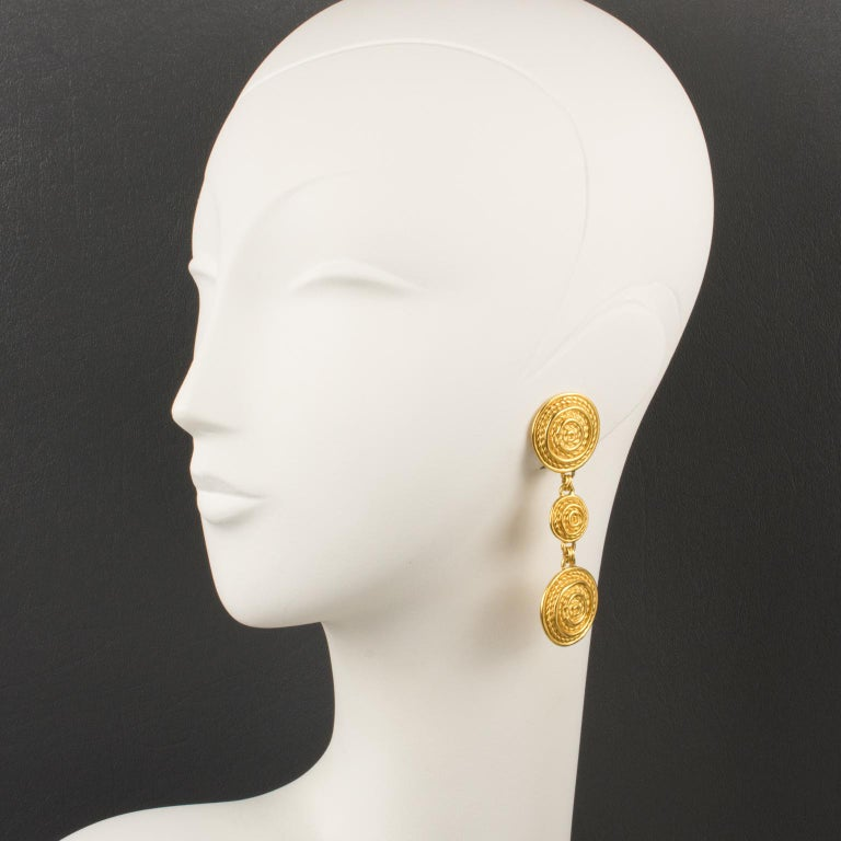 Refined Christian Dior Paris clip-on earrings. Long dangling geometric shape with gilt metal all textured. Marked underside