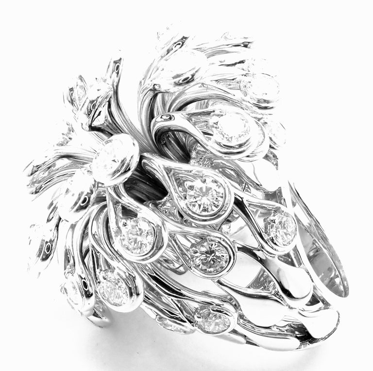 18k White Gold Large Flower Diamond Ring by Christian Dior.  With Round brilliant round cut diamonds VVS1 clarity, E color total weight approx. 6.50ct Details:  Size: European 53, US 6 1/4 Weight: 58 grams Width: 37mm Stamped Hallmarks: Dior 750 53