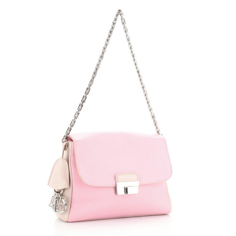 This Christian Dior Diorling Shoulder Bag Leather Large, crafted from pink neutral multicolored leather, features chain link shoulder strap, exterior back pocket, and silver-tone hardware. Its push-lock closure opens to a pink leather interior