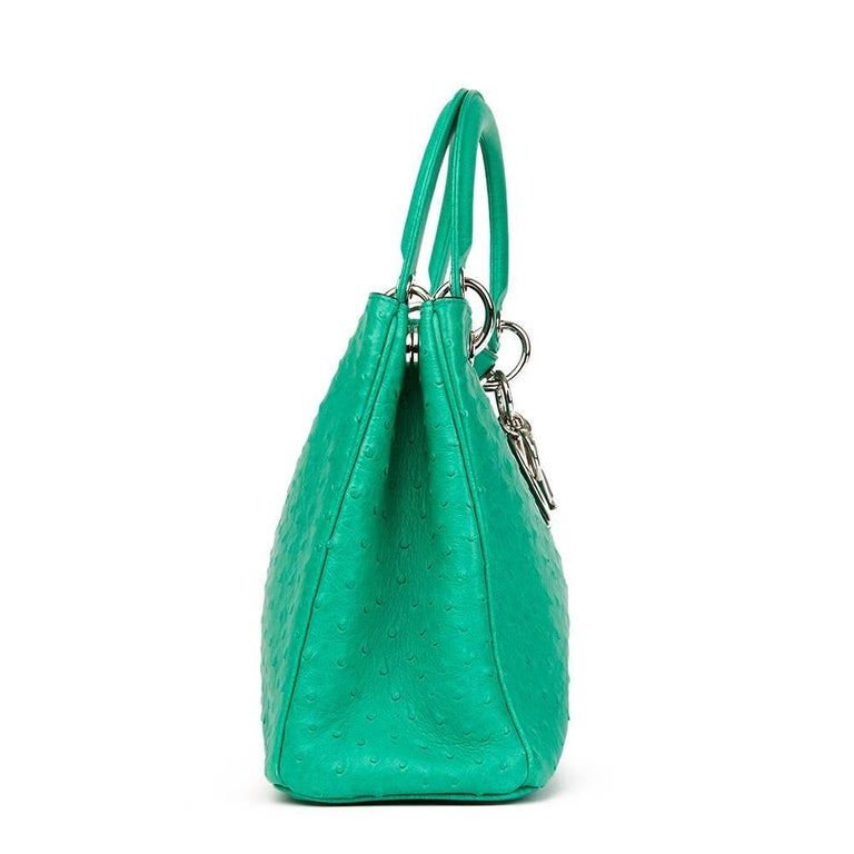 CHRISTIAN DIOR Emerald Ostrich Leather Diorissimo MM  Xupes Reference: HB1751 Serial Number: 09-MA-0123 Age (Circa): 2013 Accompanied By: Dior Dust Bag, Shoulder Strap, Interior Pouch Authenticity Details: Serial Stamp (Made in Italy) Gender: