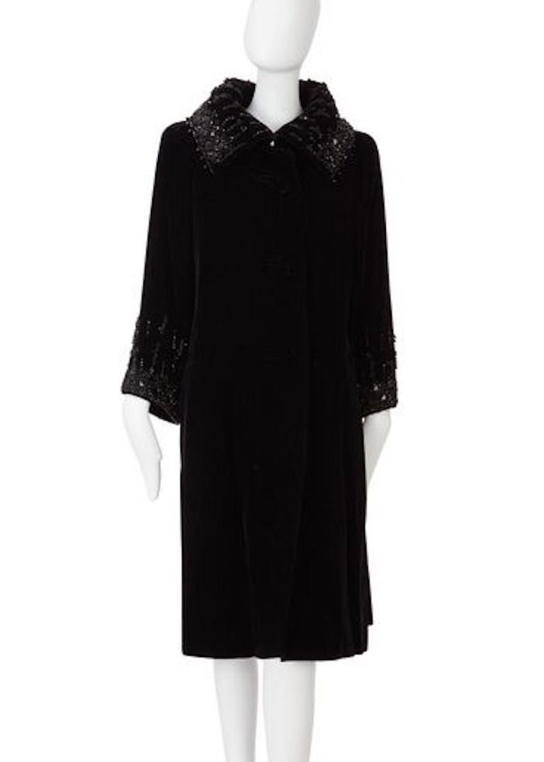 Evening coat in black silk velvet with three velvet covered buttons to the front. Swarovski embellished detailing to the collar and cuffs. Has original Christian Dior London label.