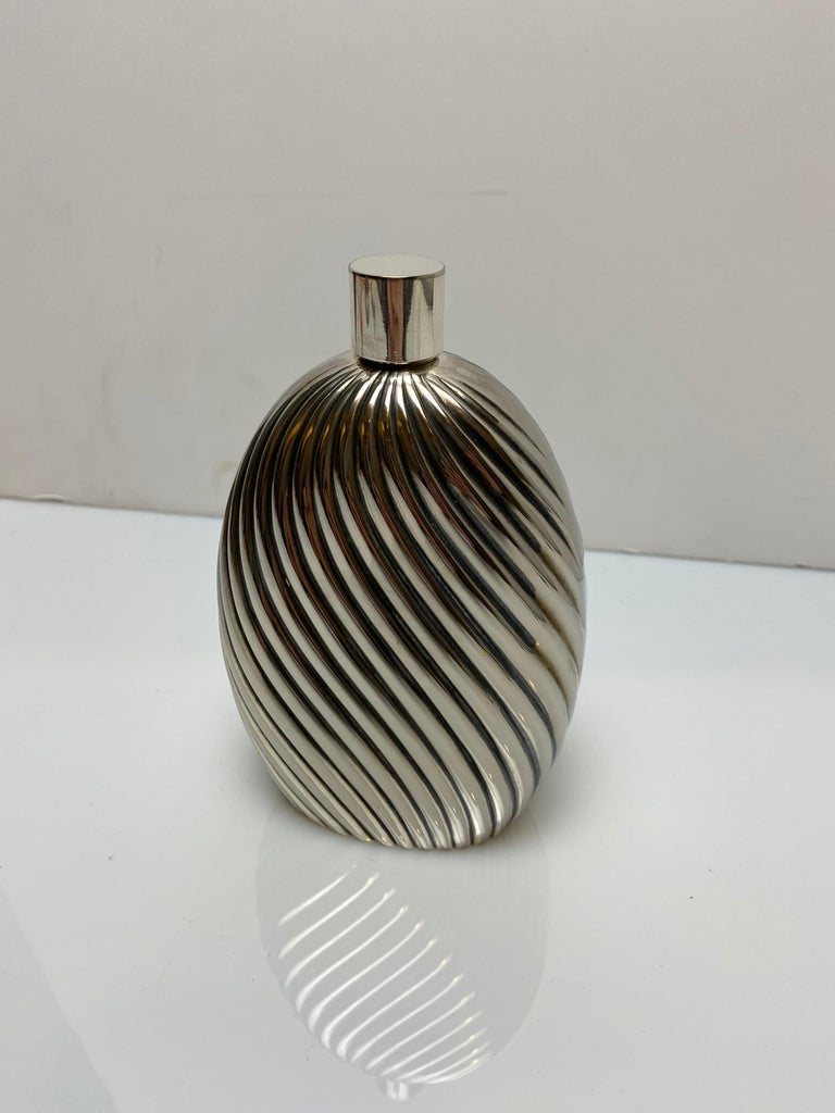 A beautiful fluted flask made by Christian Dior, featuring a screw off cap. Marked on bottom.