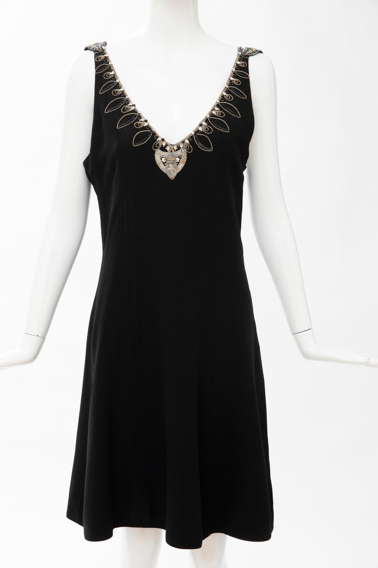 Christian Dior Boutique Paris Gianfranco Ferré, 1991 numbered  black embroidered dress ensemble.   The princess line dress has embroidered sequin, diamanté neckline, corded back straps, side zip and fully lined in black silk.   The open front