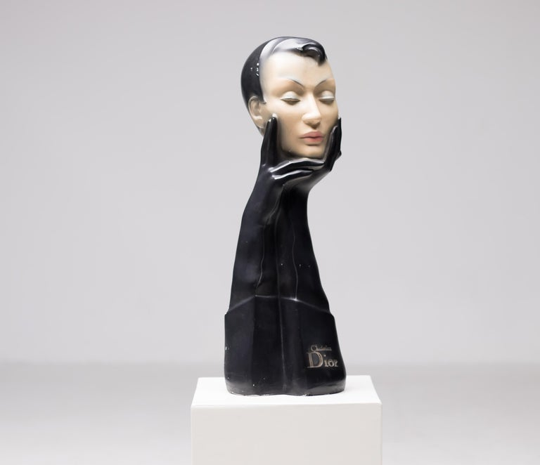 Christian Dior gloved mannequin head. Designed to display glasses, scarves or hats, by Christian Dior in the 1950s. This mannequin was made by the Gemini Company. Signed Christian Dior. A piece of Art Deco chic and elegance, this mannequin is made