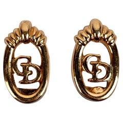 Christian Dior Gold Metal Oval CD Logo Clip On Earrings