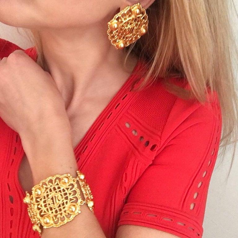Women's Christian Dior Goldtone Logo Bracelet 1980s For Sale