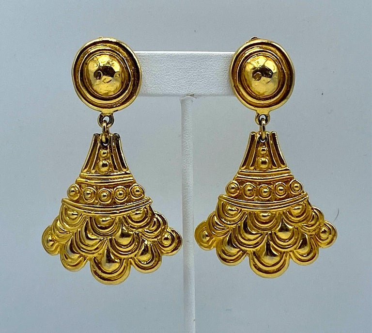 A marvelous and rare pair of ancient Etruscan revival style earrings from the 1970s by Christian Dior. Each part of the earring is meticulously carved and cast with beadwork and a scallop design typical of ancient Etruscan jewelry. The earrings are
