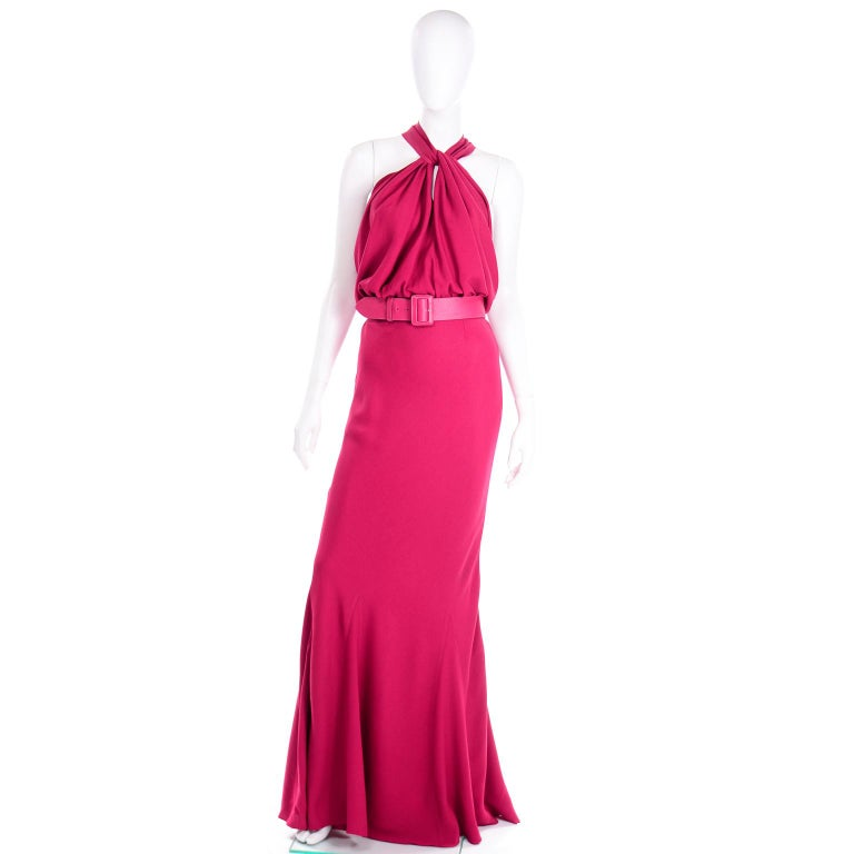 This incredible vintage 2009 John Galliano Christian Dior dress is in a stunning raspberry pink magenta crepe. This 1930's inspired dress is cut on the  bias in a mermaid style silhouette. There are really unique zig zag seams along the hem of the