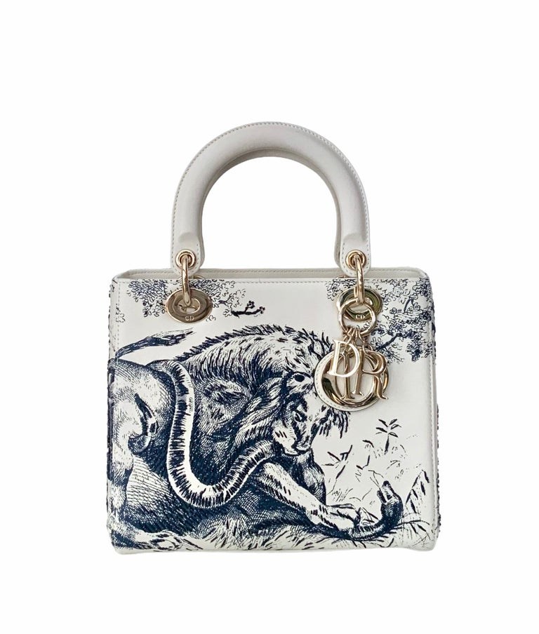 This Limited Edition Lady Dior bag is crafted in a delicate neutral calfskin leather and the Toile de Jouy print (dating from 1947 in the house of Christian Dior) has been enhanced with beadings.  Another beautiful piece designed by Maria Grazia