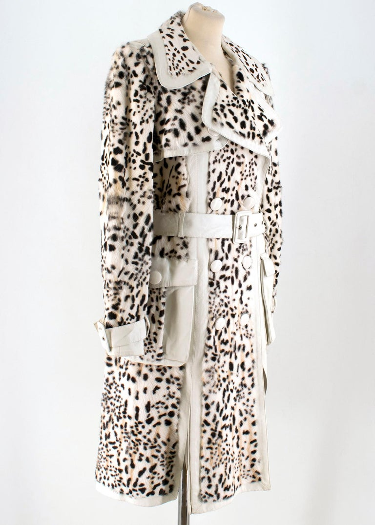 Christian Dior Lynx Print Leather and Goat Fur Coat   - White and Black Coat  - Lynx Spotty Printed  - White lambskin leather  - Goat details  - Wide lapel, double breasted  - Dual side pockets - Leather belt at waist - Belted sleeves - Silk