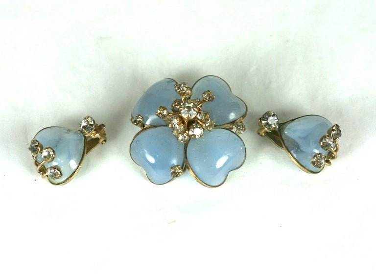 Christian Dior Maison Gripoix Demi Paure, consisting of a flower brooch and petal ear clips. Of blue moon stone poured glass enamel, with crystal paste accents. Excellent Condition.  Ear clips L 3/4