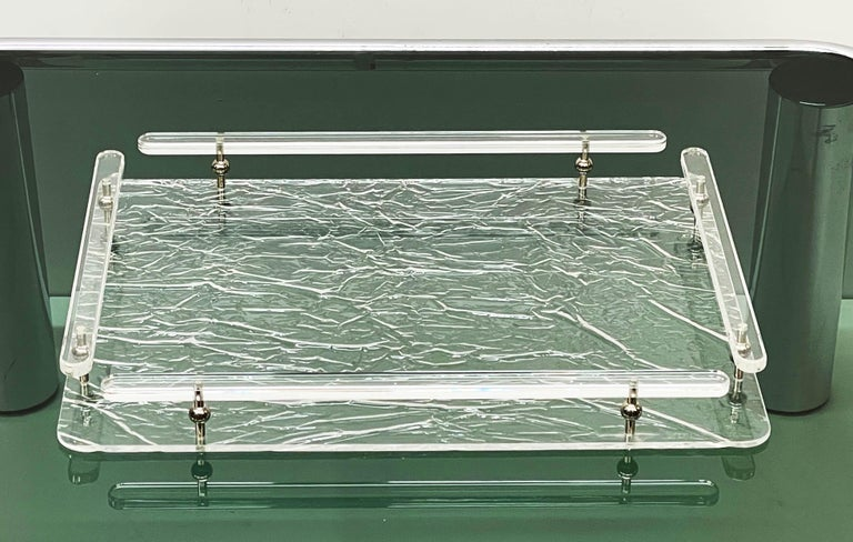 Wonderful midcentury crystal lucite serving tray with an ice-like effect. This fantastic piece was made in Italy in the 1980s and its design is attributed to Willy Rizzo for a Christian Dior production.  It is an iconic tray or serving plate with