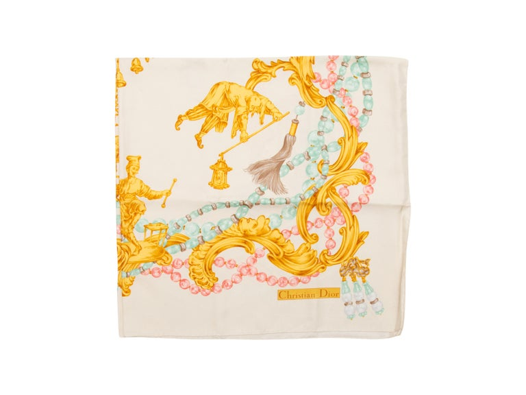 Product details:  Multicolor printed silk scarf by Christian Dior.  35