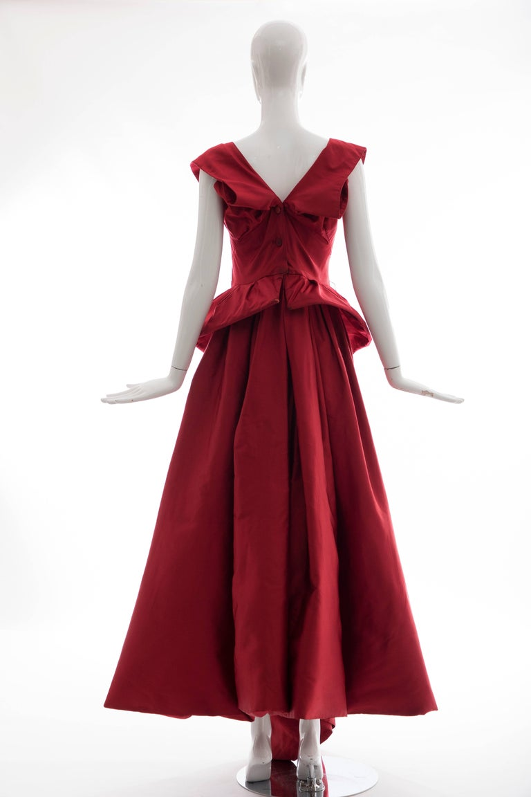 "Christian Dior New York Demi-Couture, ""New Look"", Circa 1950's silk scarlet evening dress, fitted bodice, built-in brassiere with boning and hook-and-eye closure, covered button back closure, boned peplum with full skirt fully lined in black"