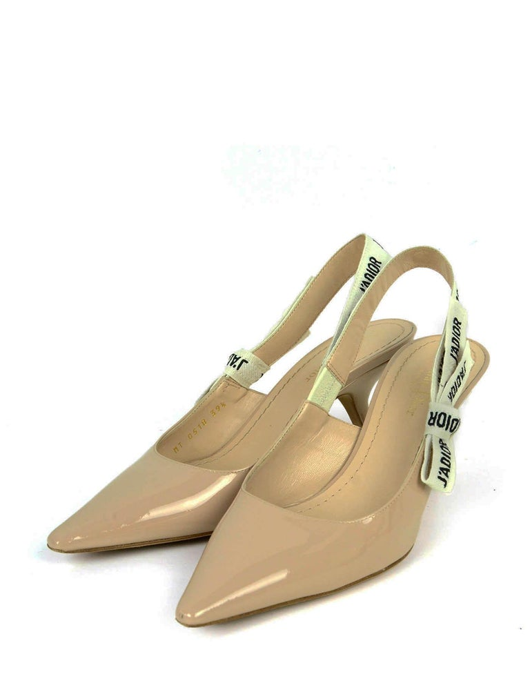 Christian Dior Nude Patent Calfskin Leather J'ADIOR Slingback Pumps  Made In: Italy Color: Nude Materials: Patent leather, fabric ribbon Closure/Opening: Slingback Overall Condition: Excellent with the exception of light wear to sole, and small