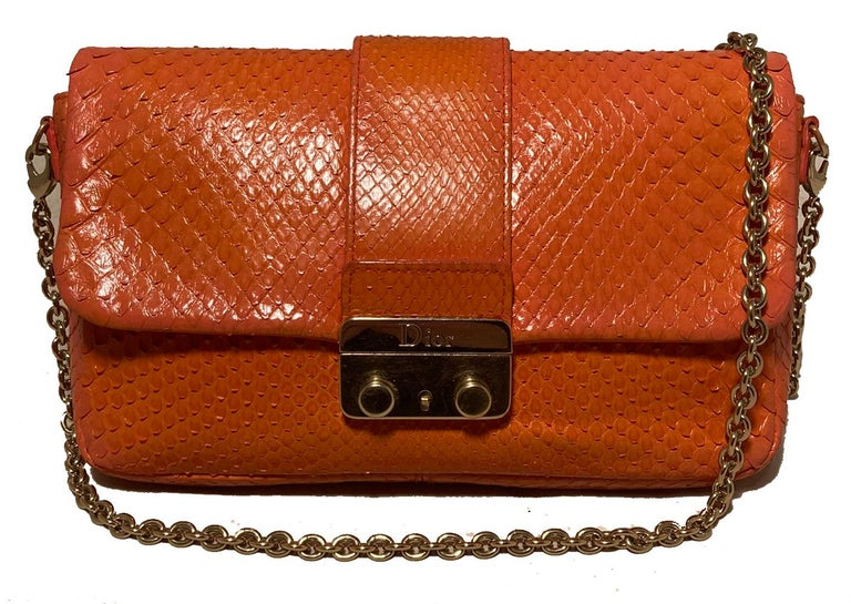 Christian Dior Orange Python Miss Dior Small Flap Bag in excellent condition. Orange python snakeskin exterior trimmed with gold hardware. Front pinch latch closure opens via single flap to an orange leather lined interior that holds one side slit