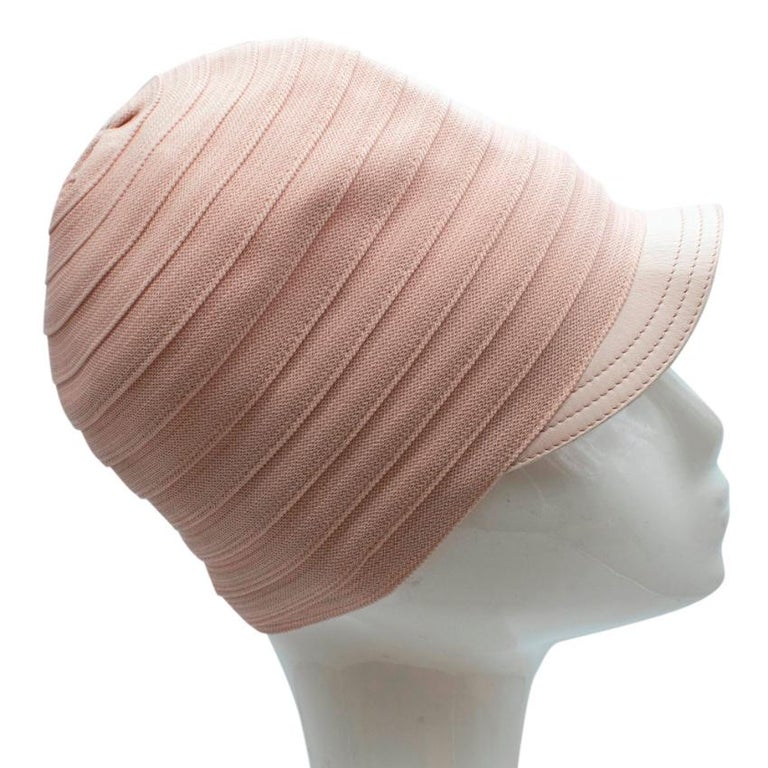 Christian Dior Pink Knit & Lambskin Hat  - Made of soft lightweight knit  - Gorgeous pink hue  - Lambskin details  - Made of a single piece of knit ribbon  - Timeless elegant design  Materials: 80% viscose, 20% nylon   Made in France   Approx.