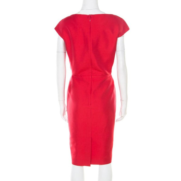 Be the talk of the town in this great dress from the house of Dior. Pair up this rouge red piece with pumps for an effortless look. Made from blended fabric, this will be your go-to outfit for any occasion.  Includes: The Luxury Closet Packaging,