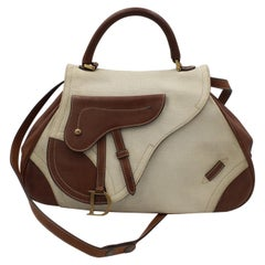 Christian Dior Shoulder Bag Saddle Bag in Canvas and Brown Leather