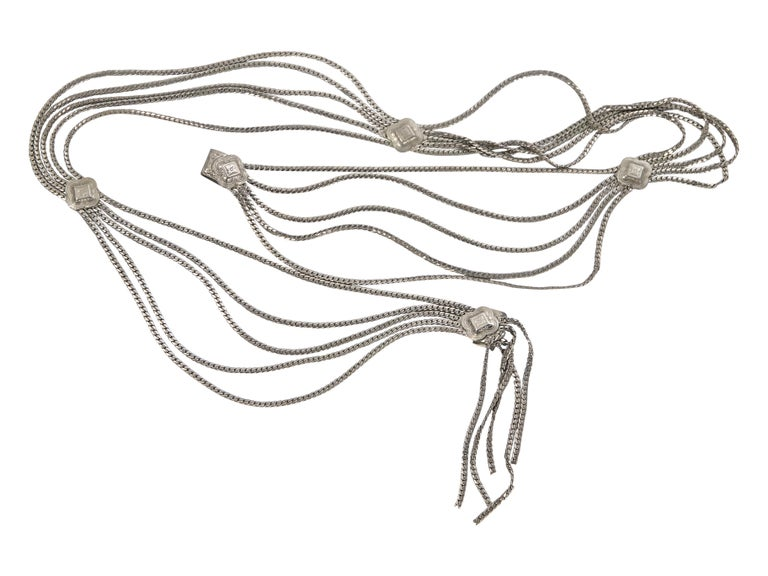 Product details:  Vintage silvertone multi-chain belt by Christian Dior.  Hook closure.  29