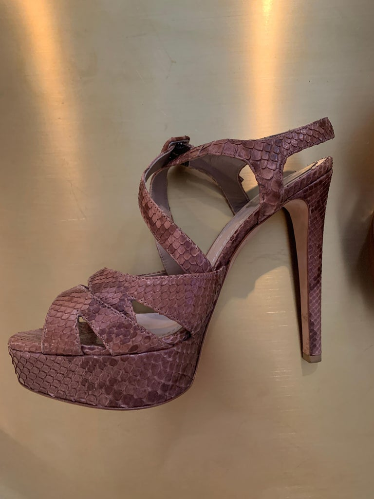 Vintage Christian Dior Snake Skin Platforms  Mint Condition - never worn  Multicolor Brown with cross strap and adjustable ankle  Slight platform for more comfort  These are show-stoppers!  Size 40