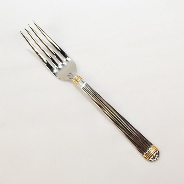 Christian Dior Stainless Steel Gaudron Flatware with Gold Accent Service for 18 In Good Condition For Sale In Philadelphia, PA