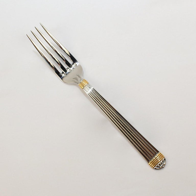 Late 20th Century Christian Dior Stainless Steel Gaudron Flatware with Gold Accent Service for 18 For Sale