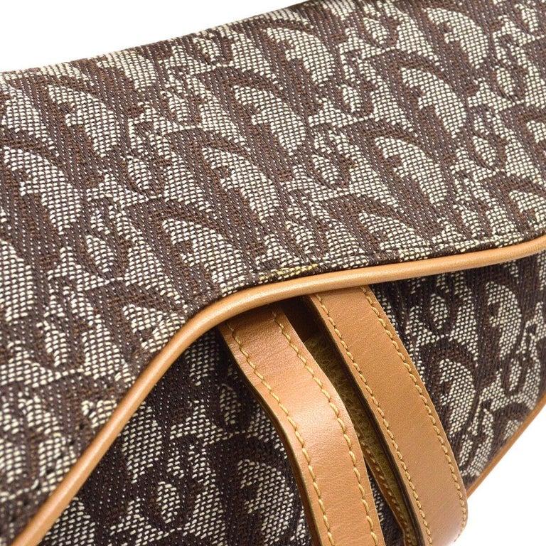 Christian Dior Tan Brown Cognac Monogram Cognac Leather 'CD' Logo Charm Saddle Shoulder Bag  Monogram canvas Leather trim Gold tone hardware Velcro closure Woven lining Made in Italy Shoulder strap drop 6.5