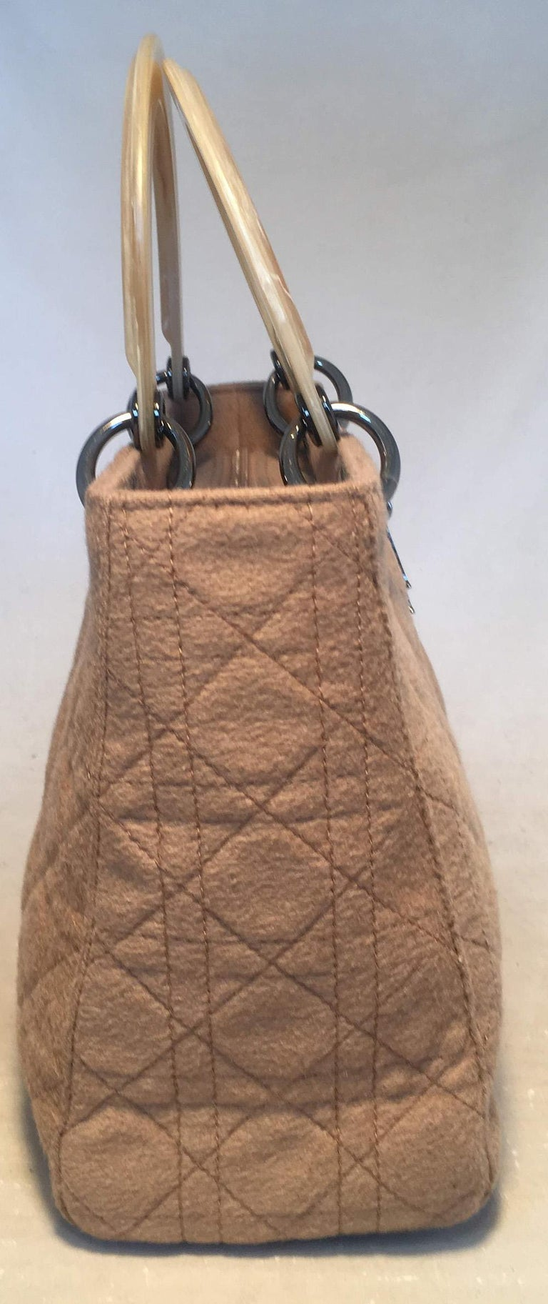 Christian Dior Tan Wool Cannage Quilted Medium Lady Di Bag excellent condition. Tan wool cannage quilted body trimmed with gunmetal hardware and beige brushed resin handles. Top flap snap closure opens to a brown nylon interior that holds one side