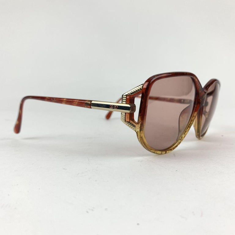 Christian Dior Vintage Sunglasses, Model 2498 - 30. Brown Optyl LCM frame with gradient effect. CD logo and gold metal detailing on temples. Brown gradient lenses. Made in Germany.   Details  MATERIAL: Plastic  COLOR: Brown  MODEL: 2498  GENDER: