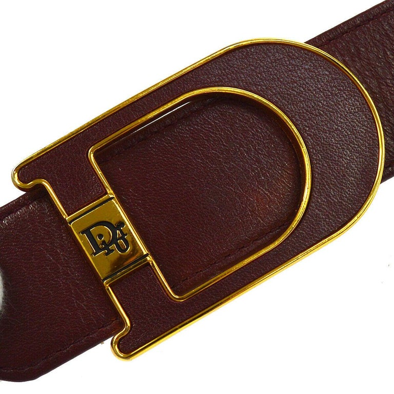 Christian Dior Wine Leather Gold Large 'D' Logo Waist Belt  Size listed 75 Leather Metal Gold tone Peg closure Width 1.75
