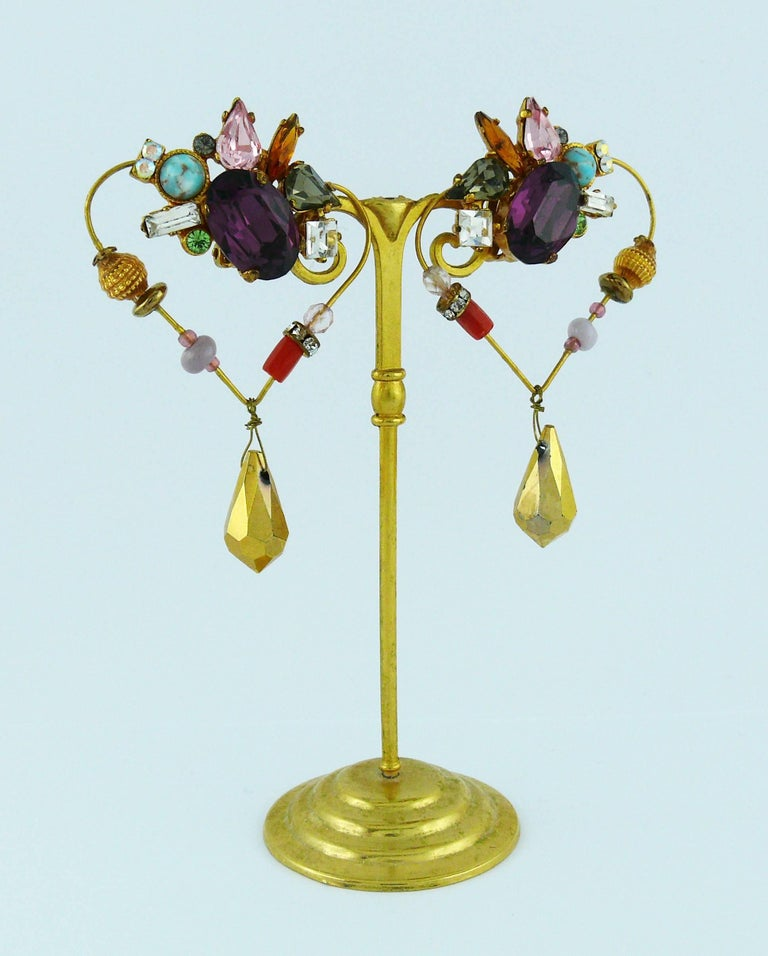 CHRISTIAN LACROIX vintage heart dangle earrings (clip-on) embellished with multicolored crystals, glass beads and faux turquoise in a gold toned setting.  Hearts are dangling.  Marked CHRISTIAN LACROIX CL Made in France.  Indicative measurements :