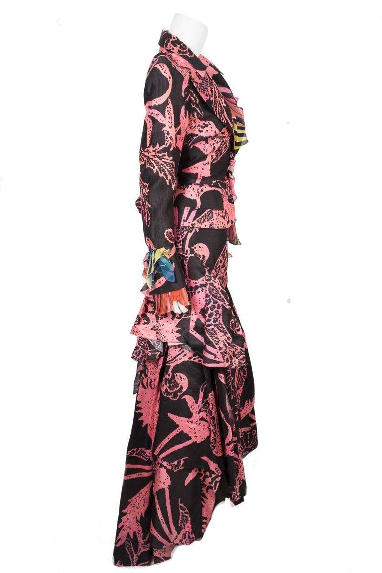 Christian Lacroix vintage black and pink abstract print blazer with matching maxi skirt with cascading ruffles at bottom. Jacket featuers multi color print silk ruffles at lapel and cuffs.   This item is previously worn with no major signs of wear.