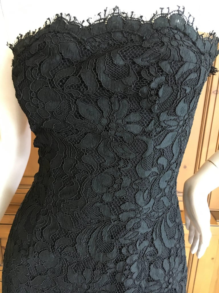 Exquisite Christian Lacroix Black Lace Strapless Mini Dress. Lacroix was a master of fashioning lace, a legacy of his Arles upbringing , and this is a wonderful example. Simple and sweet Marked size 34 but it is tiny Bust 34