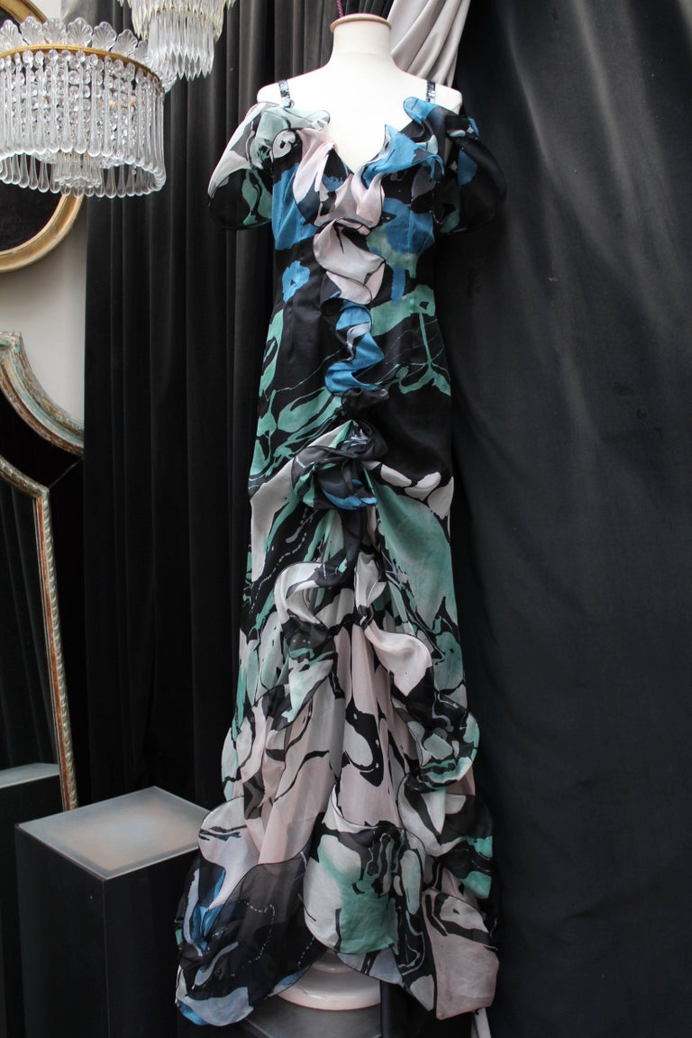 CHRISTIAN LACROIX (Made in France)  Long organza evening dress with tight-fitting cut in mermaid style, with a deep bare back . The fabric is printed with round geometric and abstract shapes in black, blue, pink and green colors. The dress is
